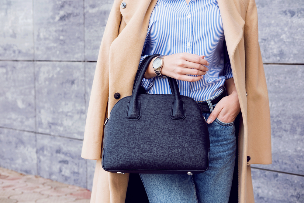 woman holding purse